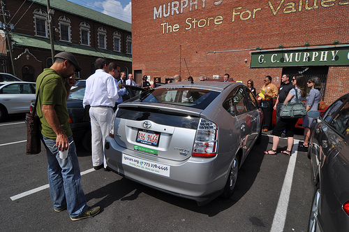 Attendees check out the IGO Prius