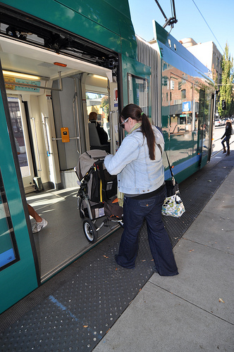 Wife loading stroller onto Streetcar