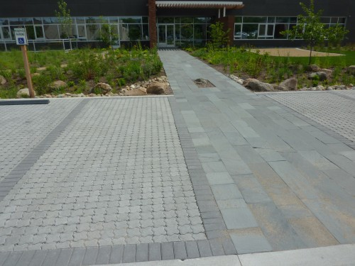 The native stone paving transitions nicely from auto to pedestrian use