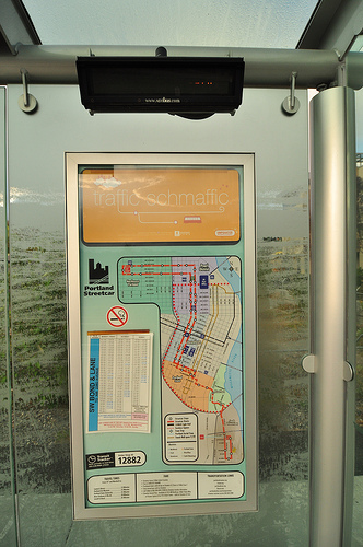 Current Portland Streetcar system map posted at a covered stop