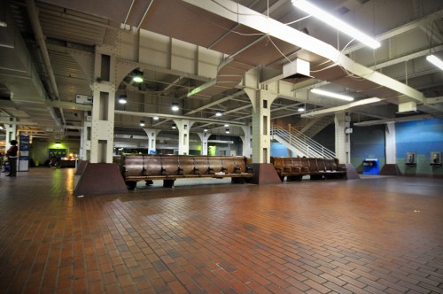 Ground floor waiting area; stairs in background access the platform