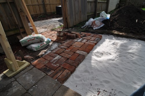Sand and limestone down, time to place bricks (image credit: Curt Ailes)