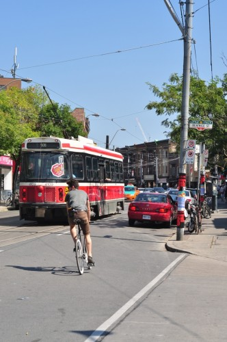 Streetcar w/ Cyclists in Little Italy (image credit: Curt Ailes)