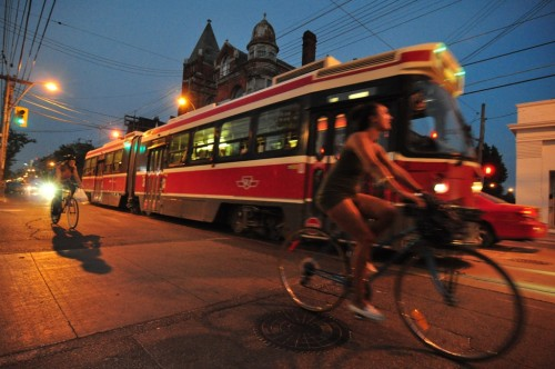 Queen St Streetcar w/ Cyclists (image credit: Curt Ailes)