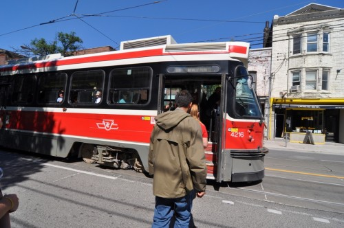 Boarding the Queen St Streetcar, Toronto (image credit: Curt Ailes)