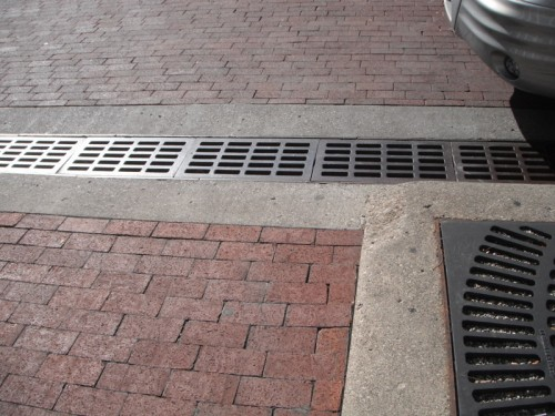 These drainage grates are customized to the Circle's unique circumference.