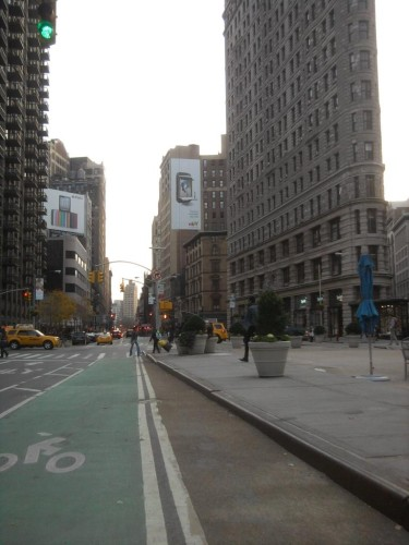 New York's bike lanes next to the Flatiron remind us that bicyclists are part of the city too and deserve space on main routes